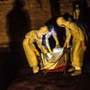 Eerie protective suits and shiny body bags have fueled rumors about the origins of Ebola. Here, a burial team removes the body of a person suspected to have died from the virus in the village of Pendembu, Sierra Leone.