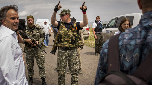 Pro-Russian rebels move journalists away from Malaysian investigators and monitors from the Organization for Security and Cooperation in Europe Tuesday. Malaysia Airlines flight MH17 was allegedly shot down by a missile Thursday; today, U.S. intelligence says it has verified that two rebel leaders spoke by phone about shooting the plane down.