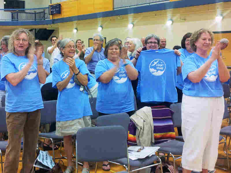 South Portland residents applaud passage of the Clear Skies Ordinance on Monday.