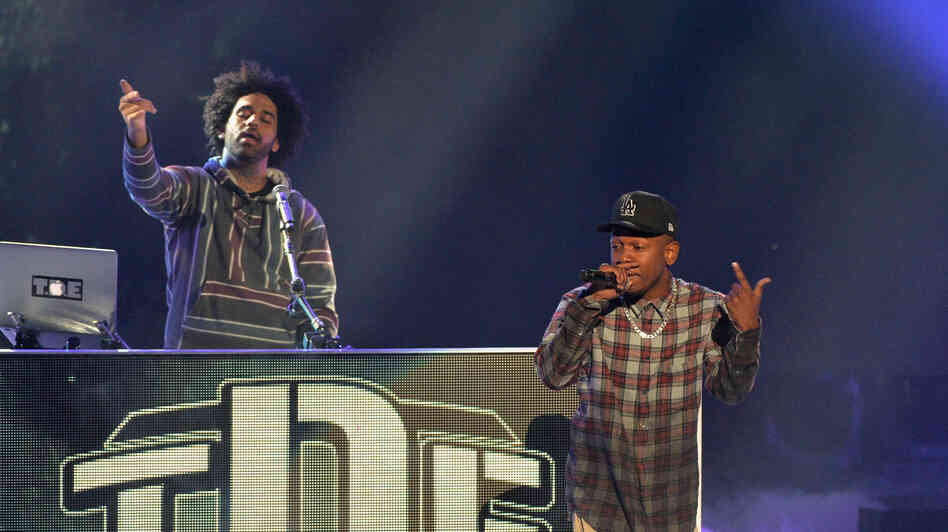 Kendrick Lamar (right) onstage at the BET Hip Hop Awards 2013 in Atlanta with Ali, TDE's engineer and sometimes DJ.