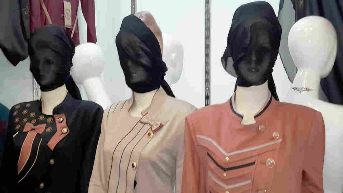 The radical Islamic State has ordered shop owners to cover the faces of mannequins in the northern Iraqi city of Mosul, shop owners say. The Islamic State has begun enforcing its strict interpretation of Islamic law in the city and other places it controls. There are mounting signs that its relationship with former members of Saddam Hussein's regime is fraying.