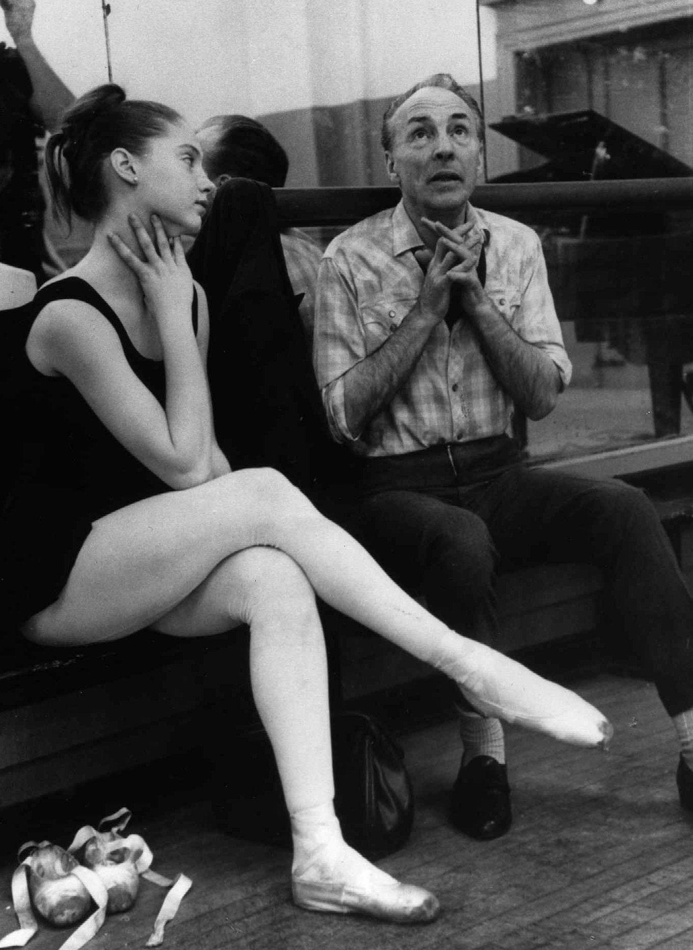 Ballerina Suzanne Farrell, 17, listens to choreographer George Balanchine during a 1963 rehearsal in New York.