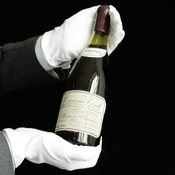 A Christie's employee presents a bottle of Romanee-Conti 1945 in Geneva, Switzerland, in May 2007.
