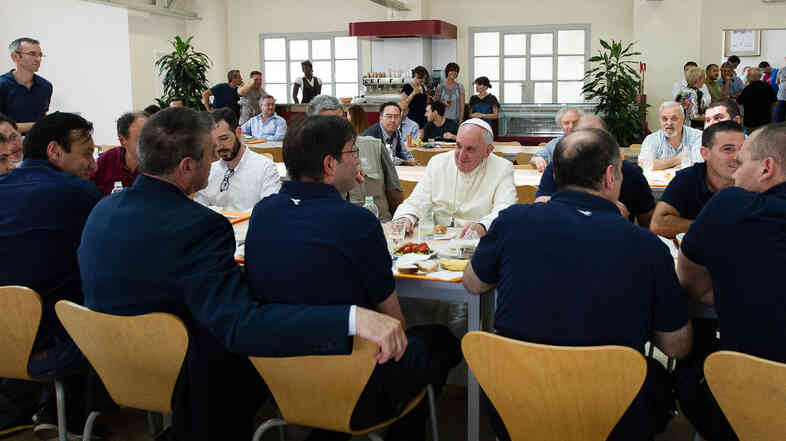 In this photo provided by the Vatican newspaper L'Osservatore Romano, Pope Francis has lunch at the Vatican workers' cafeteria on Friday.