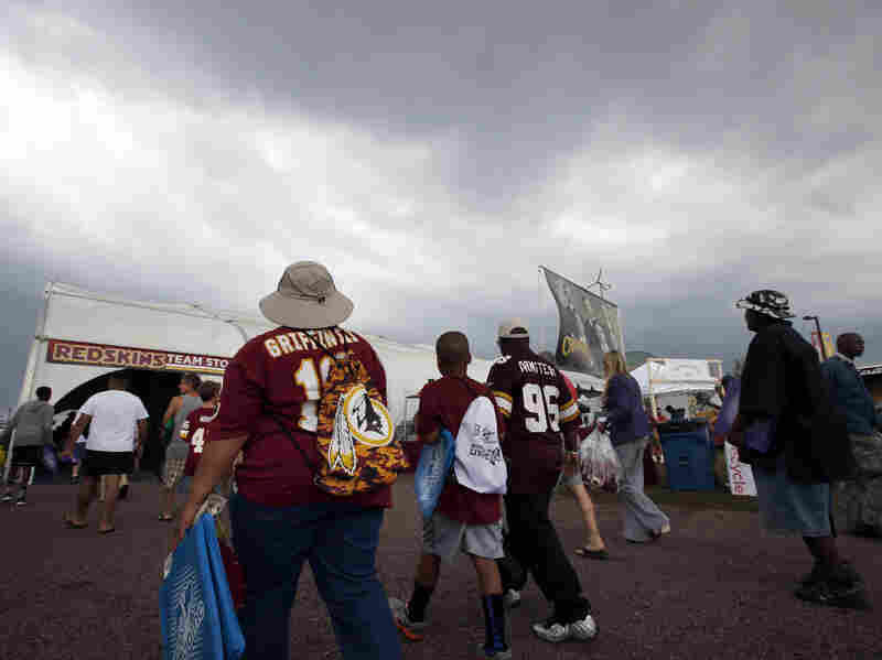 Fans leave the Washington team's training facility after rain forced the cancellation of the team's outdoor practice in Richmond, Va.