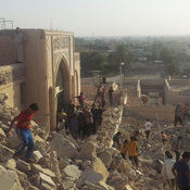 People walk on the rubble of the destroyed Mosque of the Prophet Yunus, or Jonah, in Mosul. The revered Muslim shrine was destroyed on Thursday by militants who overran the city in June and imposed their harsh interpretation of Islamic law.
