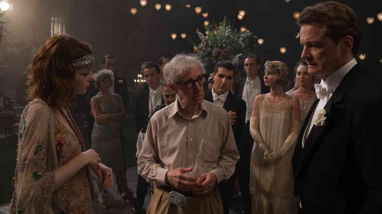 "Woody Allen (center) directs --€"" that's right, directs --€"" Colin Firth and Emma Stone in Magic in the Moonlight."