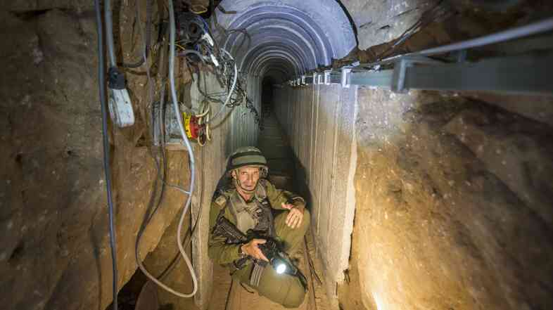 An Israeli army officer on Friday shows journalists a Palestinian tunnel that runs from the Gaza Strip into Israel. Israel says its current military campaign is aimed at destroying the tunnels.