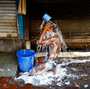 In India's Sultry Summer, Bucket Bathing Beats Indoor Showers