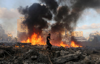 A Palestinian runs through an area damaged in an Israeli airstrike in Gaza City on Thursday. The Israeli military  has unleashed a major air and ground campaign in the fighting that's nearly three weeks old, but Hamas continues to fight back with rocket fire.
