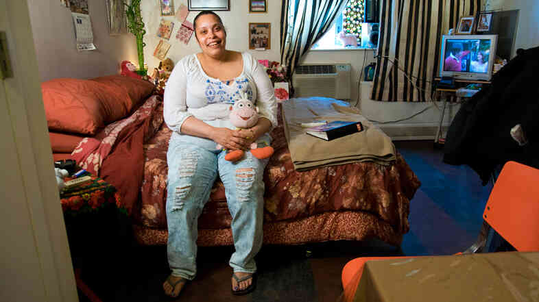 Lissette Encarnacion in her apartment at The Brook, a supportive housing complex in the Bronx.