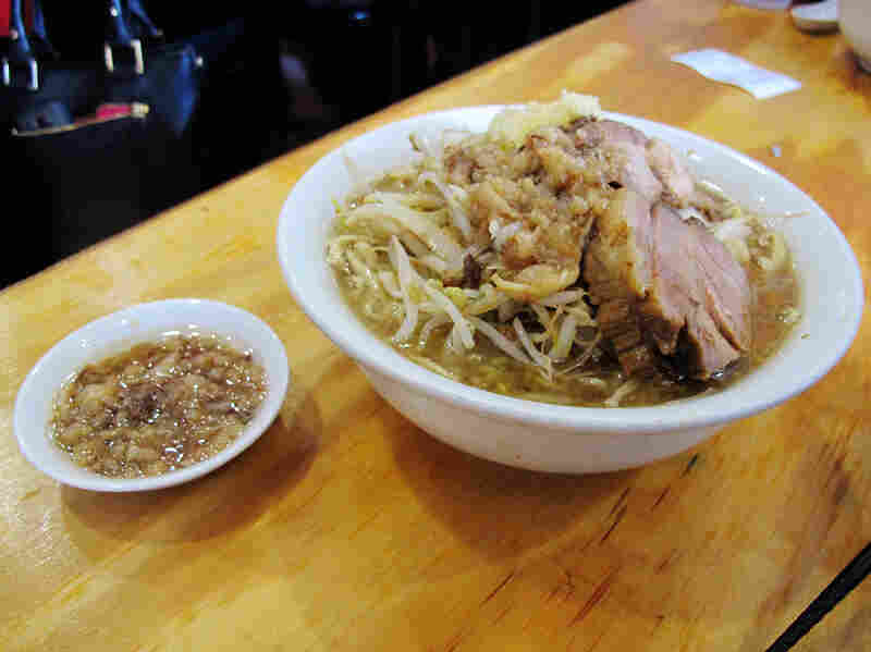 There are two choices at Yume Wo Katare: ramen topped with pork ($12), or ramen topped with more pork ($14). Extra garlic and fat can be added, too.
