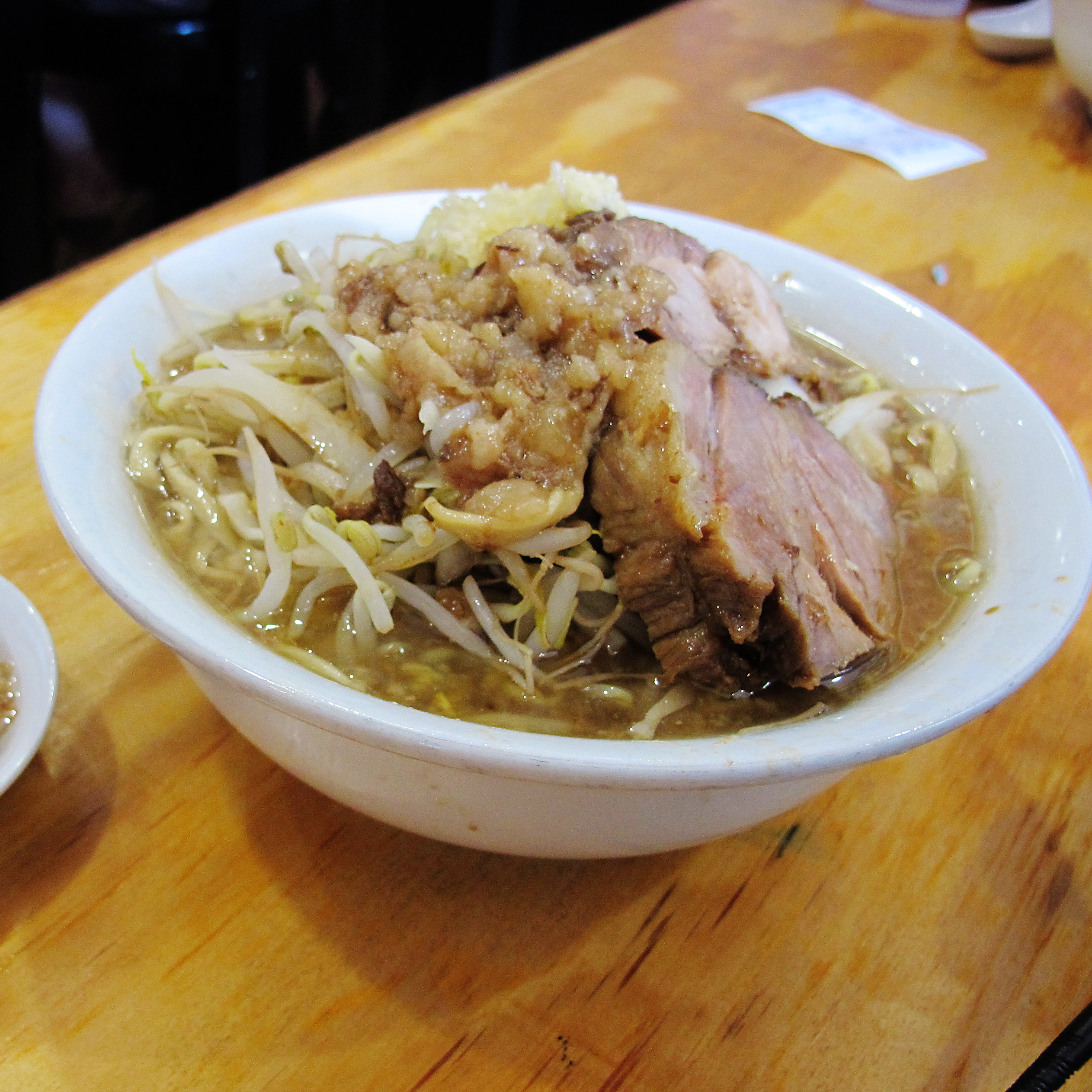 There are two choices at Yume Wo Karate: ramen topped with pork ($12), or ramen topped with more pork ($14). Extra garlic and emulsified fat can be added, too.