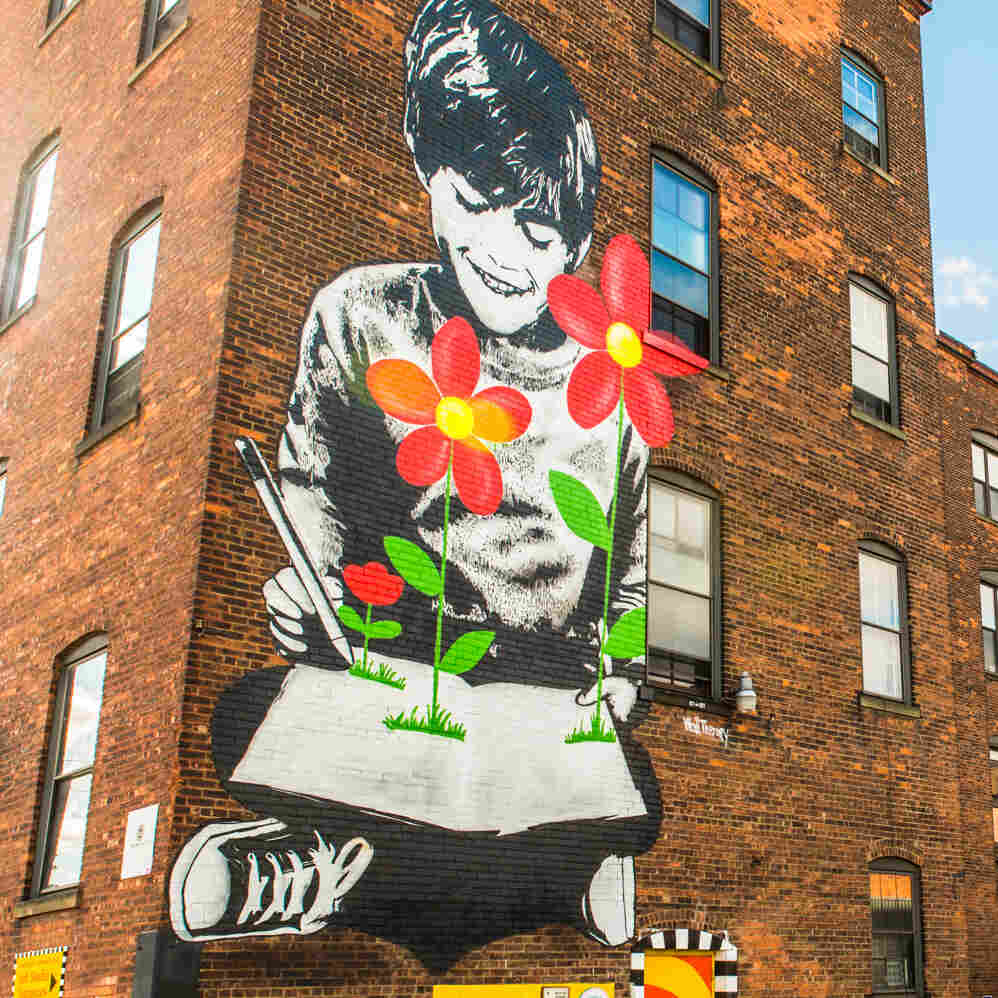 """Flower Power"" by Icy and Sot on the back wall of Rochester's Good Luck restaurant."