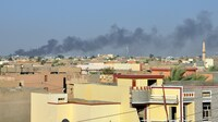 Smoke rises from buildings in May after shelling on the Iraqi city of Fallujah, which is currently held by anti-government fighters. Rights workers say civilians are being killed by government attacks with so-called barrel bombs.