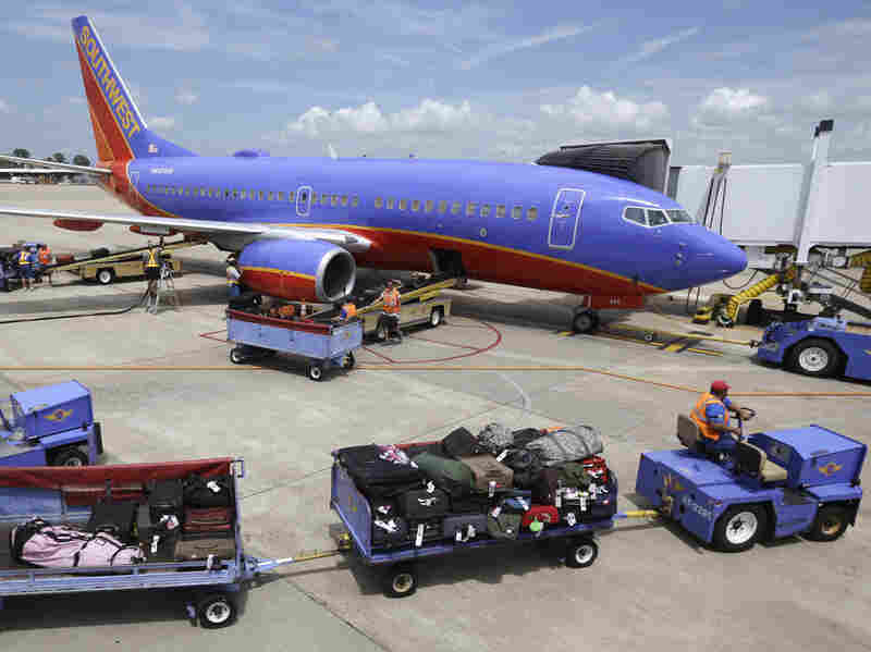 A Boeing 737 jetliner operated by Southwest awaits loading at the Little Rock, Ark., airport.