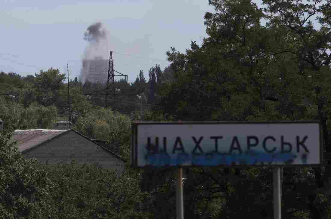 Smoke from shelling rises over a residential apartment house in Shakhtarsk, which is in the Donetsk region of Ukraine, on Monday.