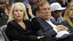 Shelly Sterling sits with her husband, Donald, during a 2010 Los Angeles Clippers game against the Detroit Pistons.