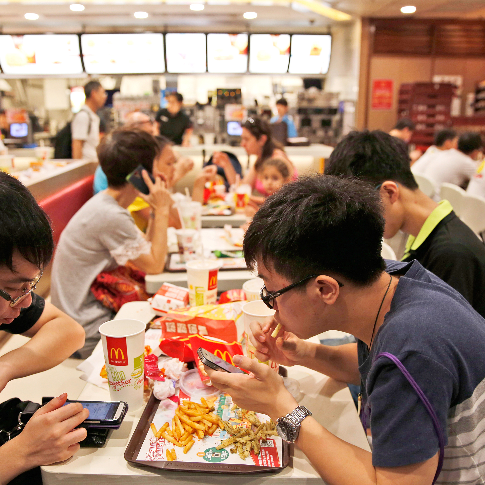 Customers eat at a McDonald's restaurant in Hong Kong Friday, July 25, 2014. McDonald's restaurants in Hong Kong have taken chicken nuggets and chicken filet burgers off the menu after a U.S.-owned supplier in mainland China was accused of selling expired meat.