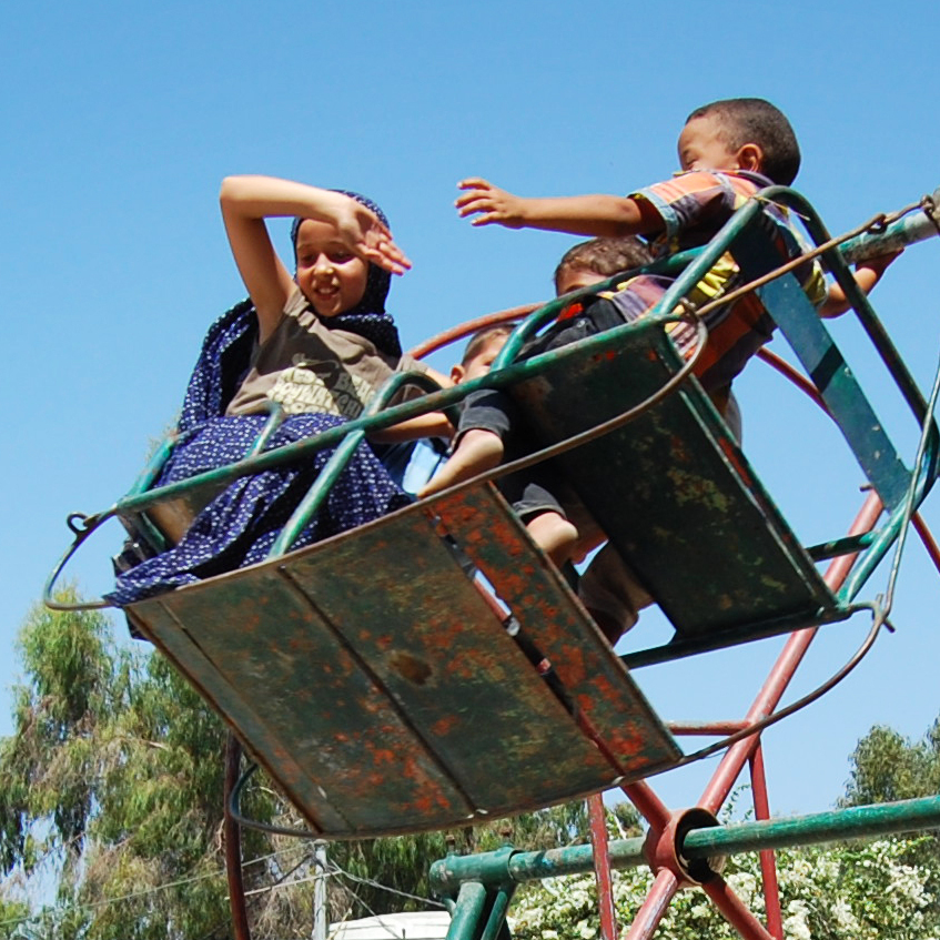 Kids play on a swing set up for Eid in Jabaliya, northern Gaza Strip.