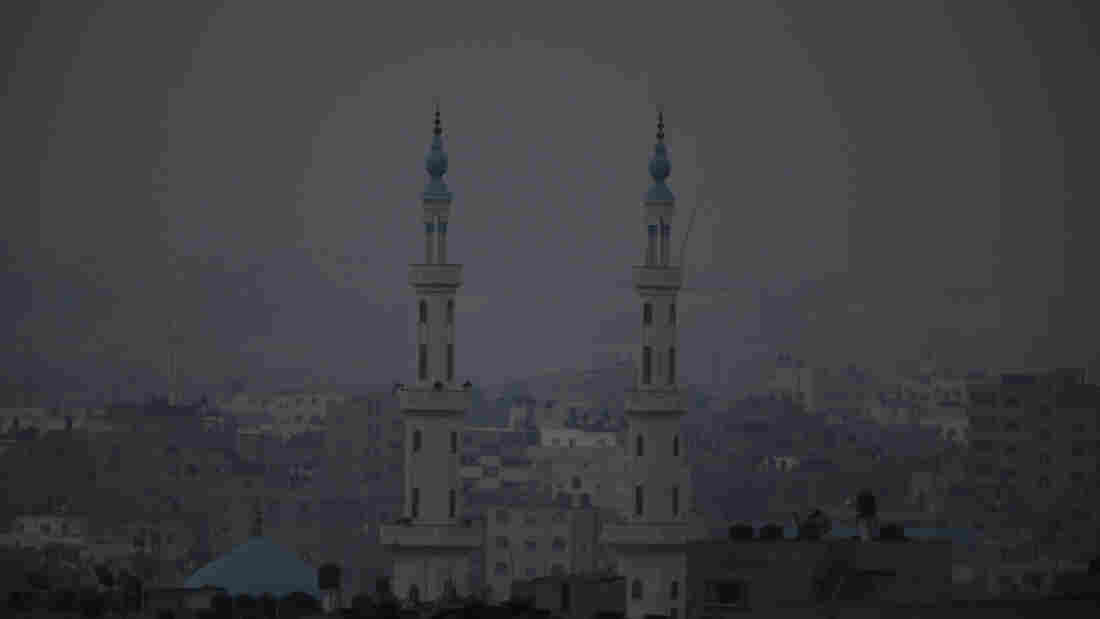 Minarets from a mosque are seen in Gaza city early Monday. Monday marks the beginning of the three-day Eid al-Fitr holiday, which caps the Muslim fasting month of Ramadan.