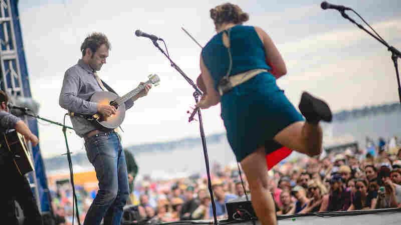 Chris Thile and Sara Watkins of Nickel Creek perform at the 2014 Newport Folk Festival.