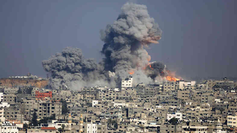 Smoke and fire rise from the explosion of an Israeli strike over Gaza City on Tuesday