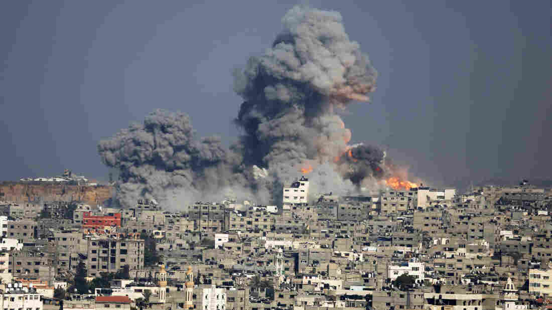Smoke and fire rise from the explosion Tuesday in Gaza City.