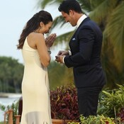 Andi gasps while accepting a proposal from Josh Murray (right, in the ill-fitting suit) on Monday night's finale of The Bachelorette.