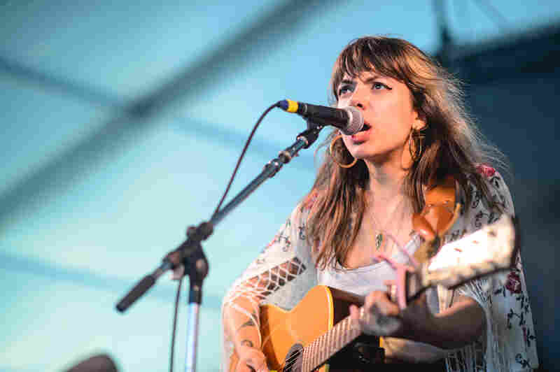 """Alynda Lee Segarra of Hurray For The Riff Raff on stage during her band's set on Sunday. Later that day she joined Mavis Staples for the dramatic finale, """"We Shall Overcome."""""""