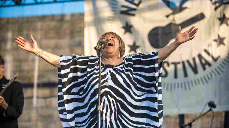 """Sunday's headliner Mavis Staples brought the Newport Folk Festival to a moving close when she led the crowd (and many of the day's performers) in """"We Shall Overcome,"""" in memory of Pete Seeger."""