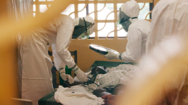 Medical workers treat Ebola patients at the Eternal Love Winning Africa hospital in Monrovia, Liberia. Three workers at the hospital, including Dr. Kent Brantly (left), have tested positive for Ebola. (Courtesy of Samaritan's Purse)