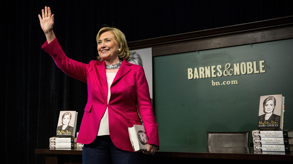 Former Secretary of State Hillary Clinton speaks to a crowd during a book signing for her new book, <em>Hard Choices</em>. Clinton's book tour has brought her before admiring audiences, but also highlighted her difficulty talking about her wealth and her presidential vision.