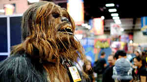 Christopher Petrone, of San Diego, CA, towering over attendees in his handmade, to-scale Chewbacca costume.
