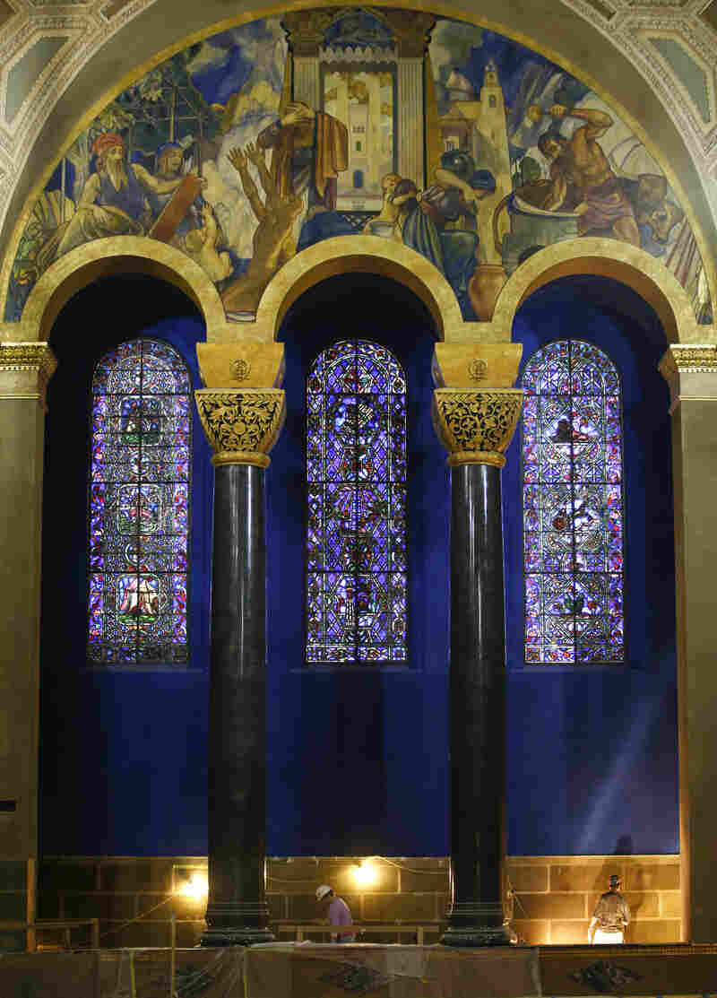 The Warner Bros. studio provided the colorful murals that recount the history of Judaism as they stretch across the walls inside the Wilshire Boulevard Temple's huge, gold-domed sanctuary. Louis B. Mayer of MGM gave the stained glass windows.