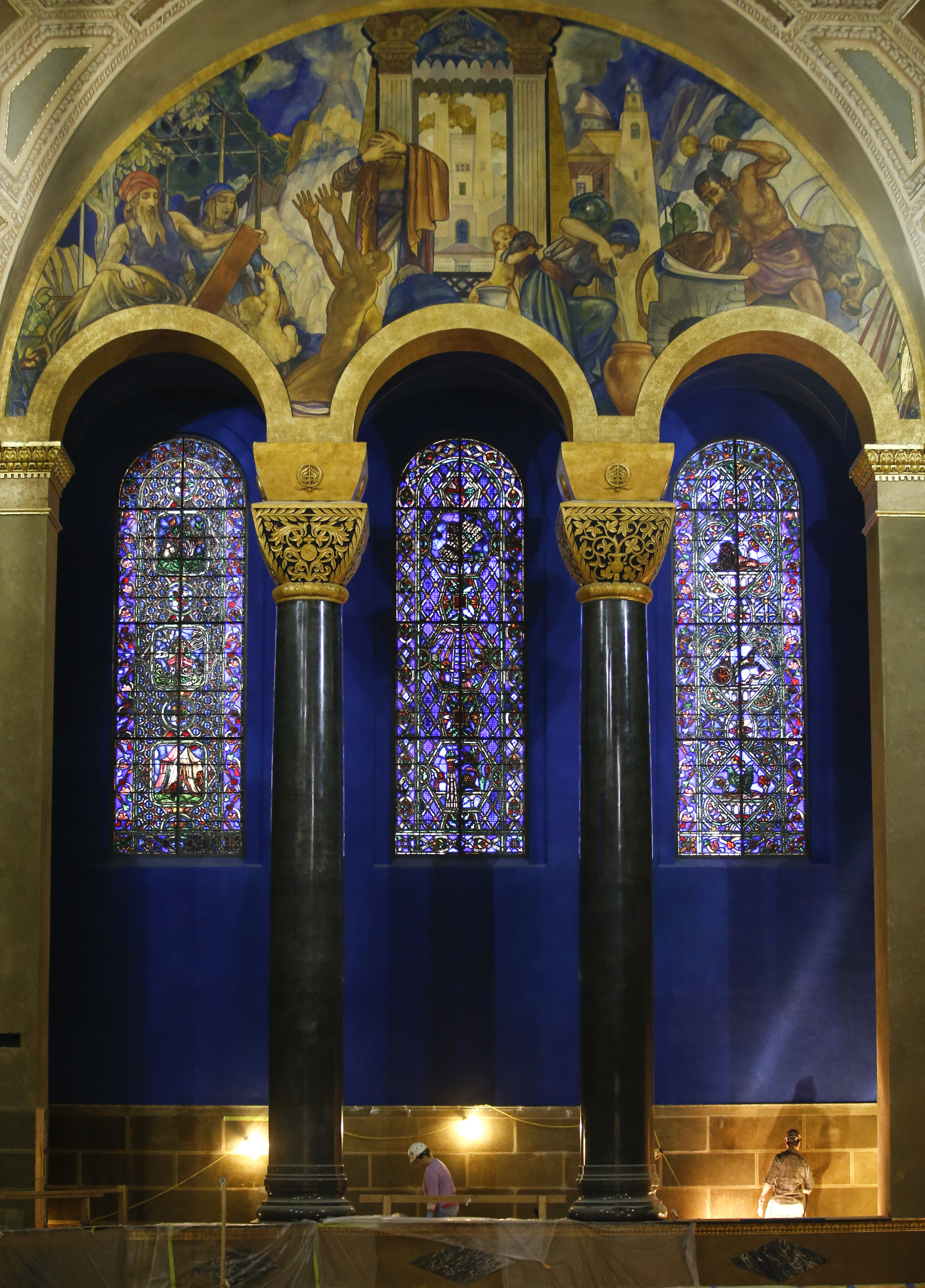 The Warner Bros. studio provided the colorful murals that recount the history of Judaism as they stretch across of the walls inside the Wilshire Boulevard Temple's huge, gold-domed sanctuary.