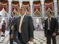 House Speaker John Boehner of Ohio strides to the House chamber Wednesday as lawmakers prepare to move on legislation authorizing a lawsuit against President Obama, accusing him of exceeding his powers in enforcing his health care law.