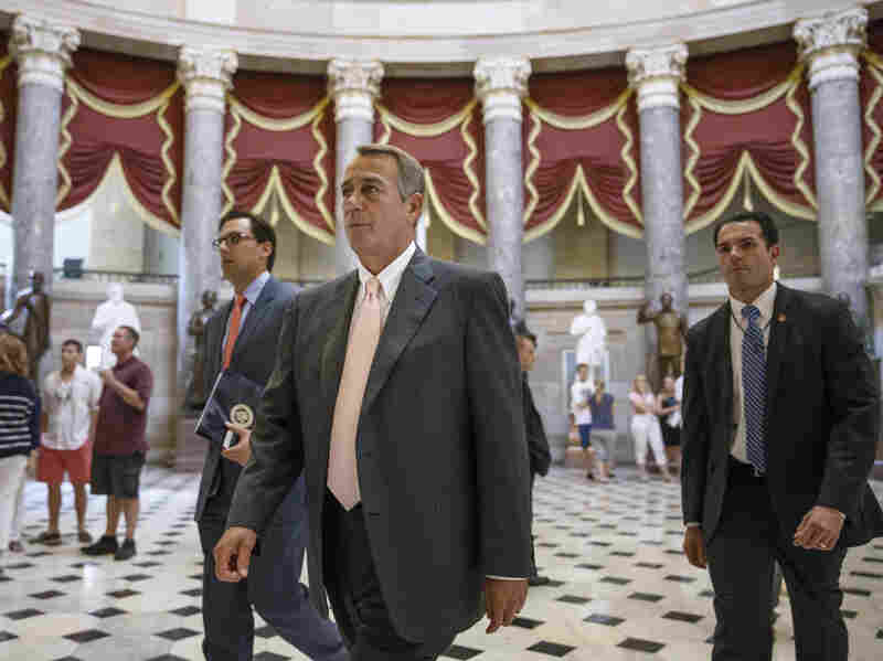Speaker John Boehner makes his way to the House chamber on Wednesday