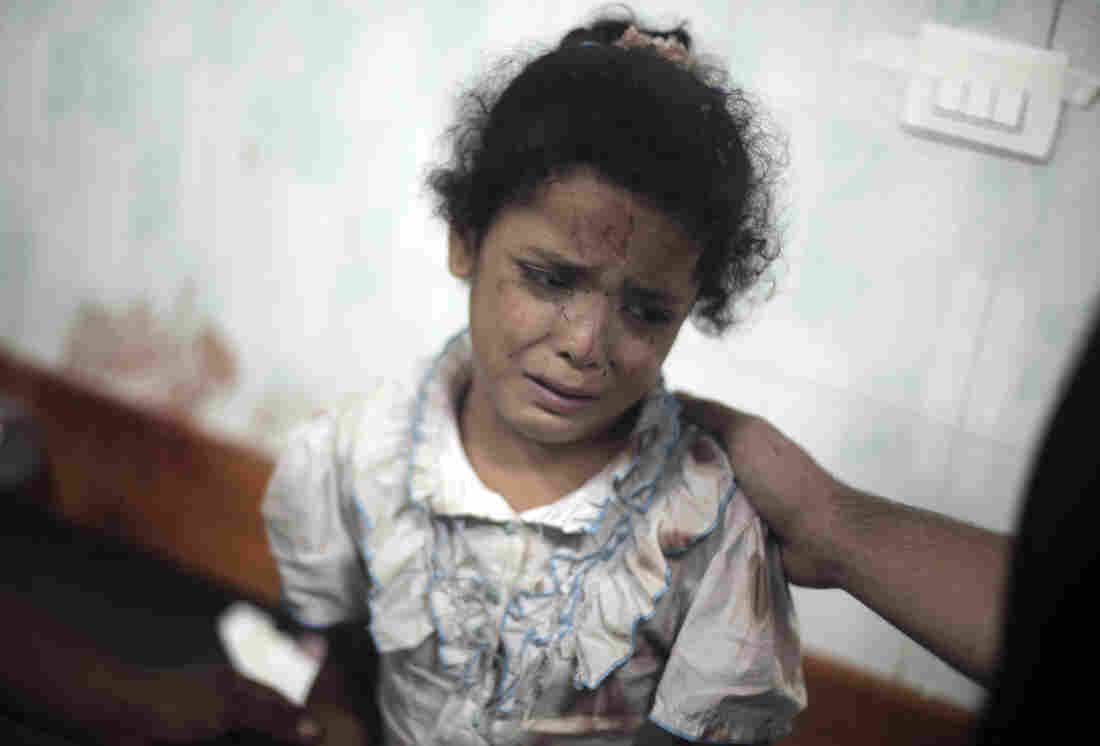 A Palestinian girl cries while receiving treatment Wednesday at a hospital in Beit Lahiya for her injuries caused by a strike at a U.N. school in the Jebaliya refugee camp.