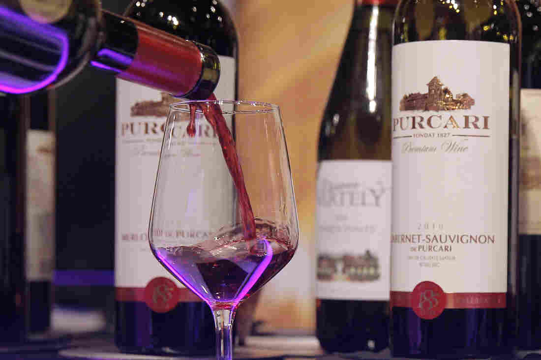 A glass is filled with Moldovan wine at a wine fair in Belgium in 2013.