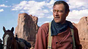 John Wayne — seen here in 1956's The Searchers — was an icon of traditional Hollywood manliness.