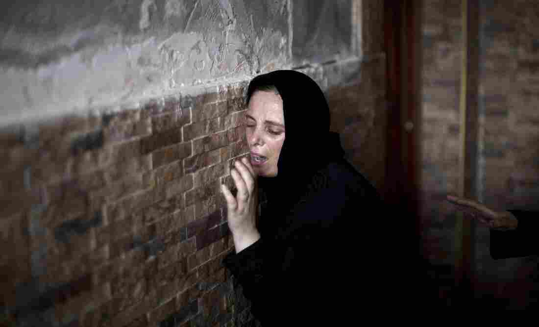 The Palestinian sister of Mohammed al-Daeri, 25, mourns during his funeral in Gaza City on Thursday.