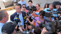 New York Gov. Andrew Cuomo is surrounded by the media in Freeport, N.Y., on Wednesday, Cuomo was on Long Island to announce a new program to help victims of Superstorm Sandy but ended up fielding questions about the Moreland Commission.