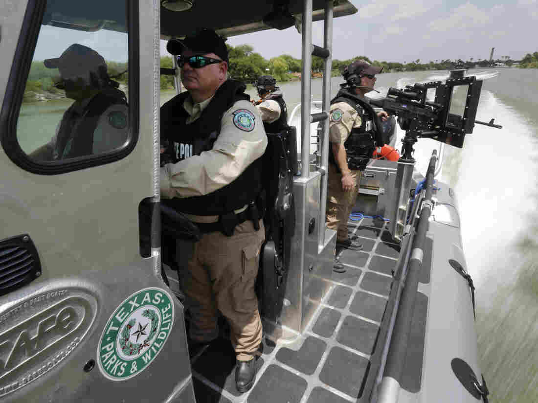 Texas Parks and Wildlife wardens patrol the Rio Grande on the U.S.-Mexico border in Mission, Texas, earlier this month.