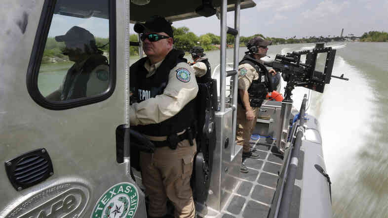 Texas Parks and Wildlife Wardens patrol the Rio Grand on the U.S.-Mexico border in Mission, Texas, earlier this month.