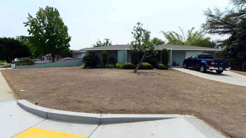 A dried-out lawn is seen in the city of Glendora, east of Los Angeles, this week. About 58 percent of California is now under the most extreme drought conditions, a new report says.