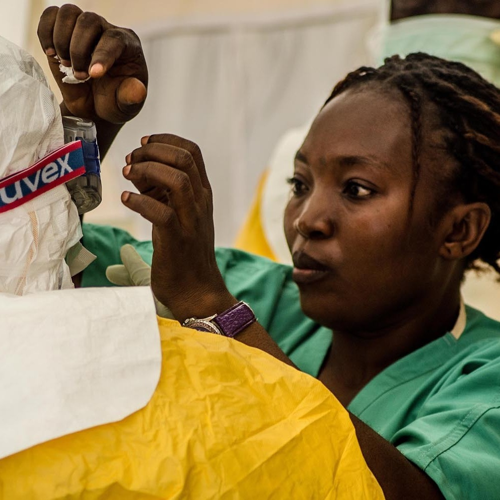 A nurse helps health workers suit up before treating Ebola patients at an isolation ward run by Doctor's Without Borders in Kailahun, Sierra Leone.