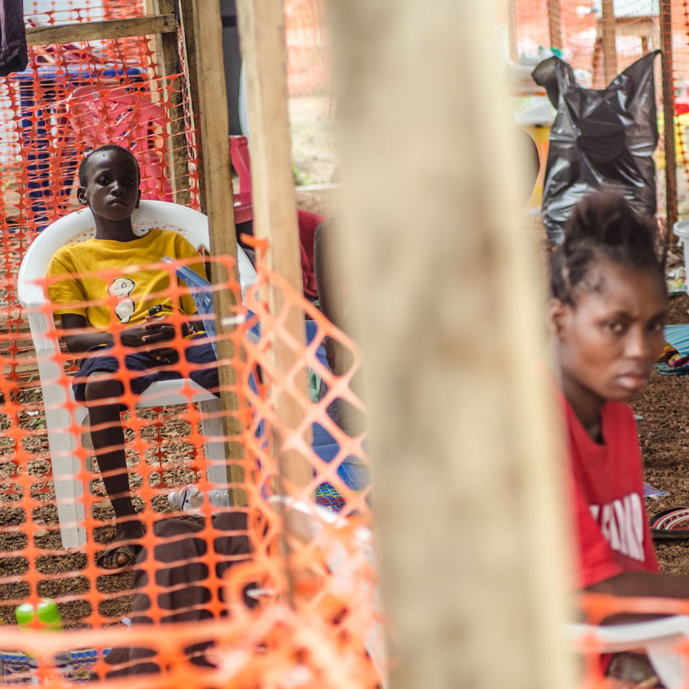 Two young patients rest at an Ebola isolation area run by Doctors Without Borders in Kailahun, Sierra Leone.