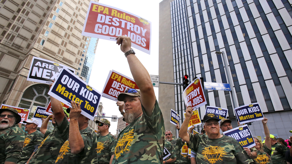 Some 5,000 union members, led by the United Mine Workers of America, march outside the William S. Moorhead Federal Building on Thursday in Pittsburgh. The city hosted two days of public hearings by the Environmental Protection Agency on stricter pollution rules for coal-burning power plants.