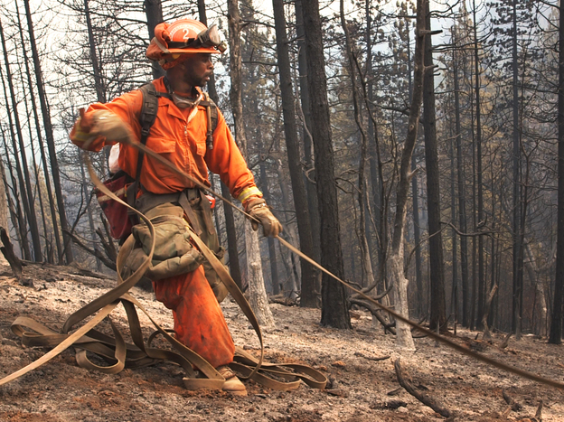 Emir Dunn, an inmate firefighter stationed at the Chamberlain Creek Conservation fire camp in California, at work on a fire. About 4,000 inmate firefighters battle blazes across the state.